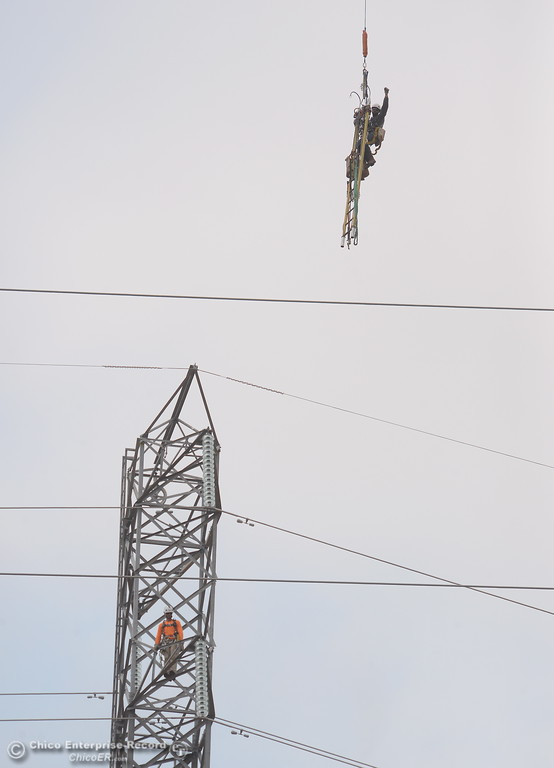 . Up, up and away! Fearless PG&E Linemen are plucked from a tower by a helicopter as work continues near the Lake Oroville Dam Spillway in Oroville, Calif. Thursday Sept. 14, 2017. (Bill Husa -- Enterprise-Record)