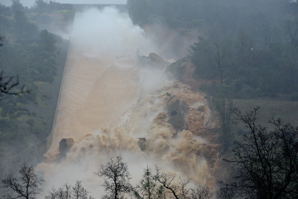 . As more water makes it\'s way down the damaged spillway, mud and debris spray and tumble as they find a new path to the Feather River at the Oroville Dam Spillway Wednesday Feb. 8, 2017. (Bill Husa -- Enterprise-Record)