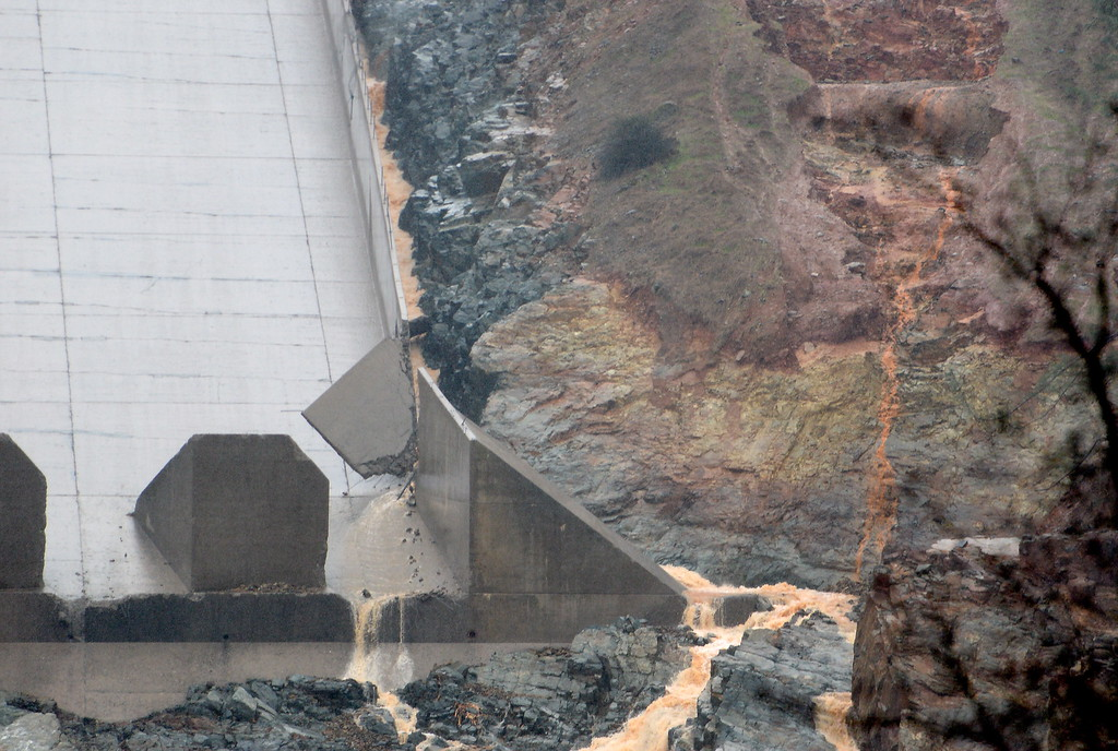 . A section near the bottom is seen breaking apart before the release Thursday. The hole from the damaged Oroville Dam controlled Spillway continues to grow larger as water is released Thursday Feb. 8, 2017.  Erosion along the left side continues to increase as the spillway falls apart. (Bill Husa -- Enterprise-Record)