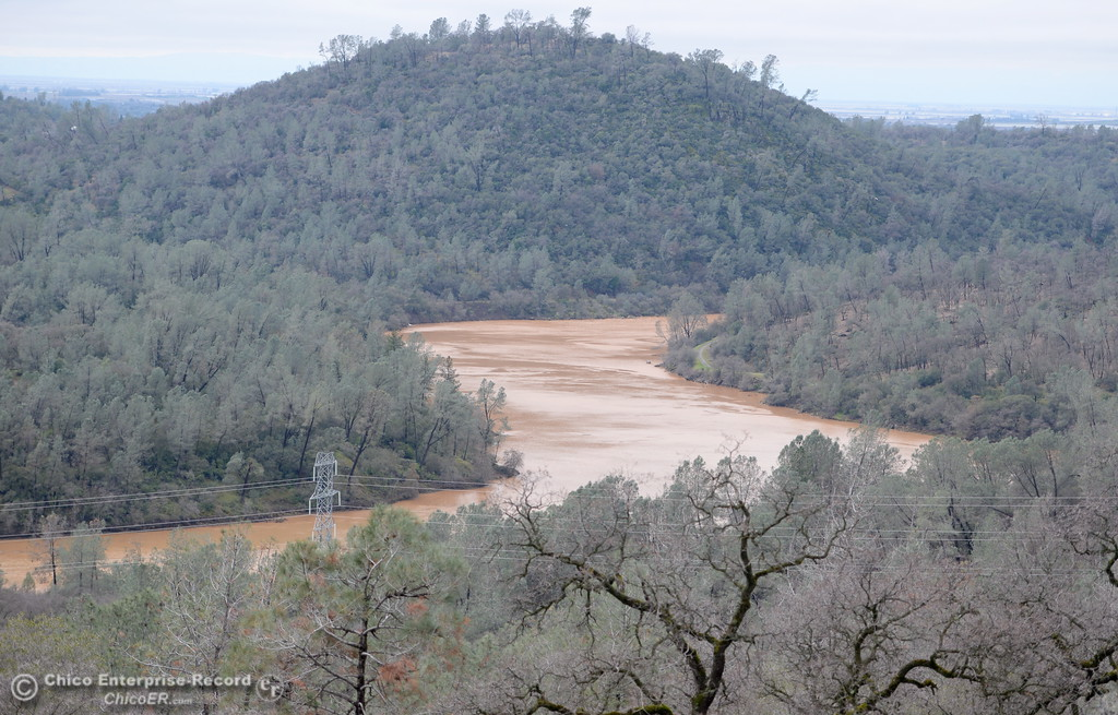 . Muddy water flows down the Feather River after the Lake Oroville Dam Spillway sustained erosion damage Tues. Feb. 7, 2017. (Bill Husa -- Enterprise-Record)