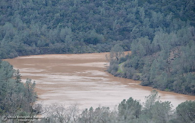 Muddy water flows down the Feather River after the Lake Oroville Dam Spillway sustained erosion damage Tues. Feb. 7, 2017. (Bill Husa -- Enterprise-Record)