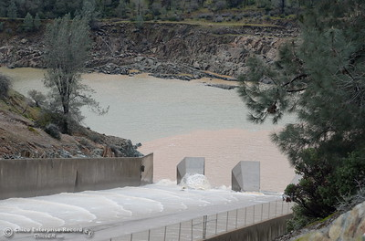 The Lake Oroville Dam controlled spillway has sustained erosion damage, the lower section below the erosion is seen here Tues. Feb. 7, 2017. (Bill Husa -- Enterprise-Record)