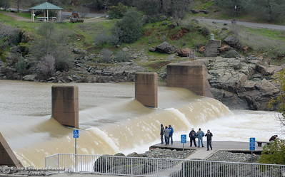 People check out the water flow over the Fish Barrier Dam at the Feather River Fish Hatchery in Oroville, Calif. Tues. Feb. 7, 2017. The gates to the hatchery are closed. (Bill Husa -- Enterprise-Record)
