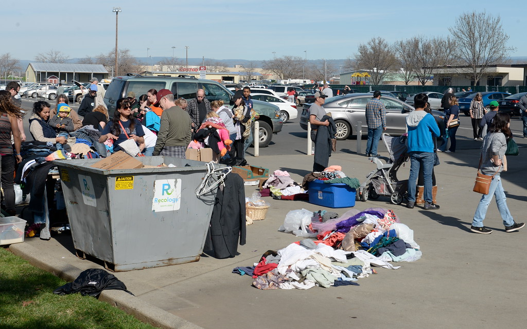 . People look through donated clothing items at the Silver Dollar Fairgrounds as the Lake Oroville Dam Spillway emergency continues in Oroville, Calif. Tues. Feb. 14, 2017. (Bill Husa -- Enterprise-Record)