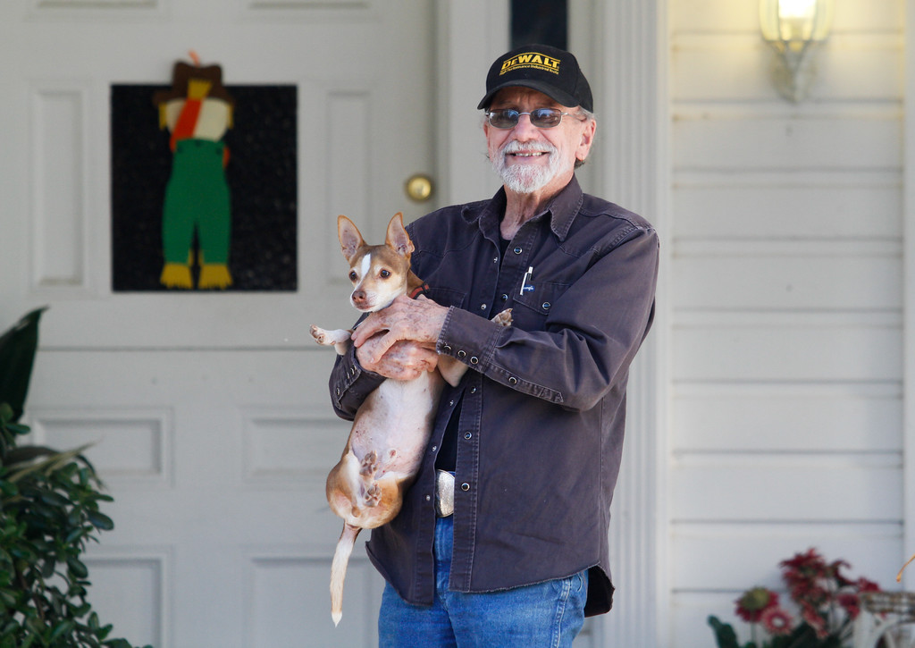 . Gayle Meadors and his dog Eddie the Fist arrive home after the emergency evacuated on Oroville was lifted Tuesday February 14, 2017 in Oroville, California. (Emily Bertolino -- Enterprise-Record)
