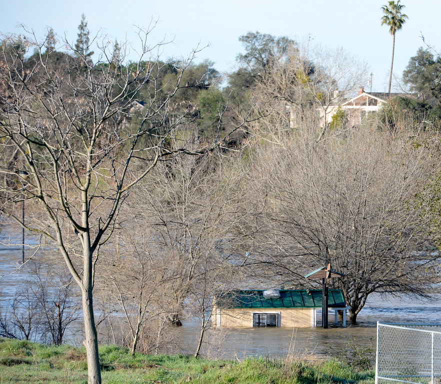 . An outbuilding at Riverbend Park appears to be floating as the Feather River continues to rise and the Lake Oroville Dam Spillway emergency continues in Oroville, Calif. Tues. Feb. 14, 2017. (Bill Husa -- Enterprise-Record)