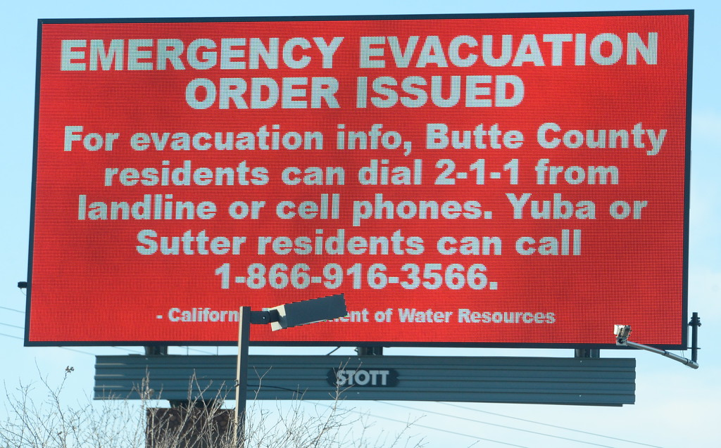 . A digital billboard shows the evacuation order Tues. morning as the Lake Oroville Dam Spillway emergency continues in Oroville, Calif. Tues. Feb. 14, 2017. The order was changed to a warning later Tuesday. (Bill Husa -- Enterprise-Record)