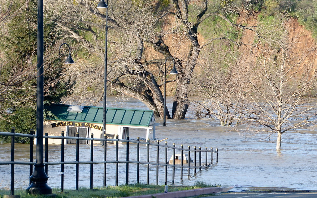 ". The ""Catch the Dream\"" booth at the entrance to Riverbend Park appears to be floating as the Feather River continues to rise and the Lake Oroville Dam Spillway emergency continues in Oroville, Calif. Tues. Feb. 14, 2017. (Bill Husa -- Enterprise-Record)"