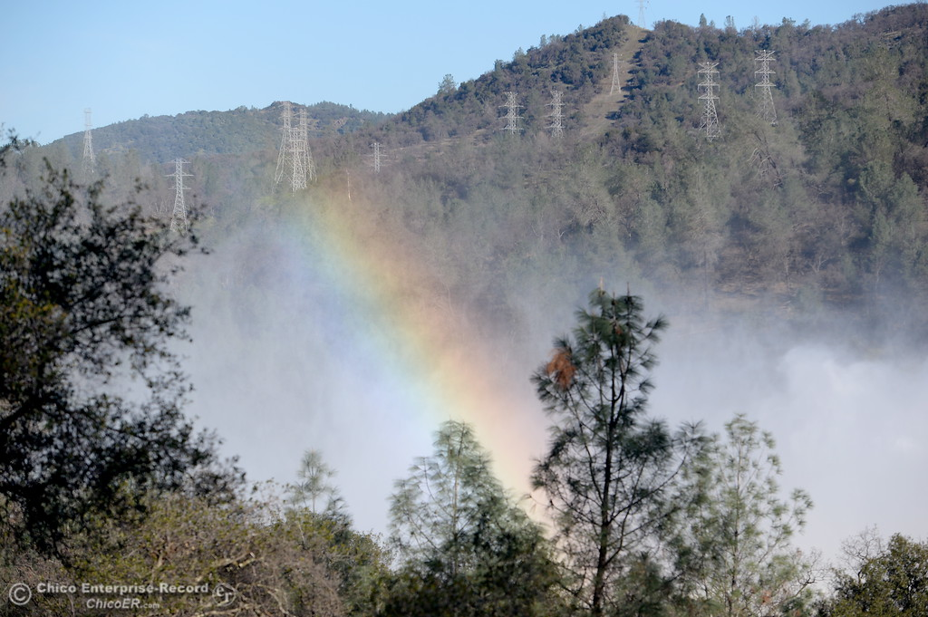 . A rainbow appears with the morning sun as the Spillway continues to pump out roughly 100,000 cfs as the Lake Oroville Dam Spillway emergency continues in Oroville, Calif. Tues. Feb. 14, 2017. (Bill Husa -- Enterprise-Record)
