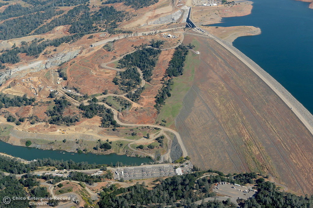 . The Lake Oroville Dam and damaged controlled Spillway are seen during a flight over the area with Oroville Pilot Gonzalo Pee Wee Curiel Friday May 26, 2017. (Bill Husa -- Enterprise-Record)