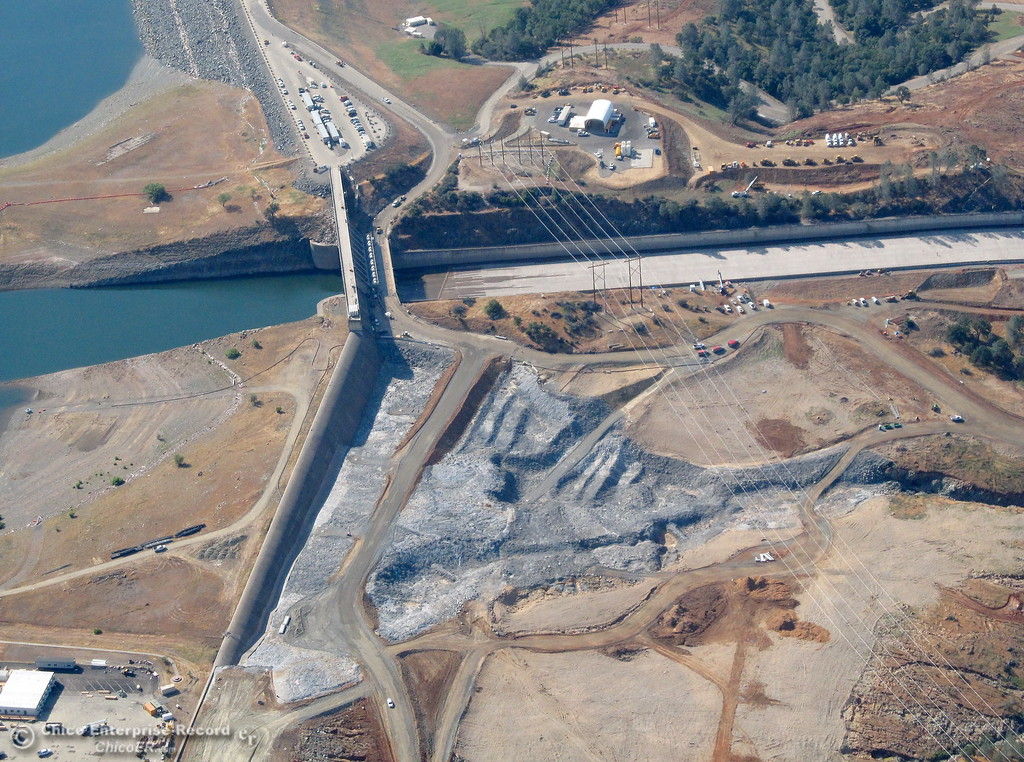 . The top of the controlled spillway and the new concrete below the emergency spillway are seen during a flight over the Lake Oroville Dam Spillway with Oroville Pilot Gonzalo Pee Wee Curiel Friday May 26, 2017. (Bill Husa -- Enterprise-Record)