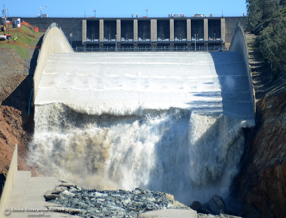 . Water begins to pour down the Oroville Dam spillway as flows are increased Friday, March 17, 2017, to 50,000 cubic feet per second in Oroville, California. (Dan Reidel -- Enterprise-Record)