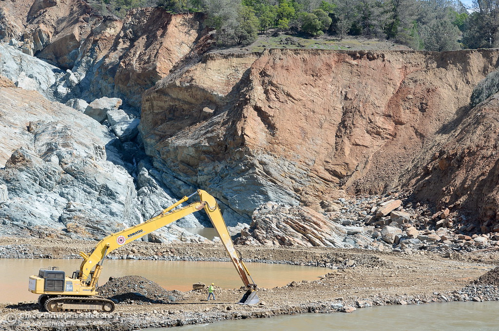 . Work continues below the damaged Oroville Dam Spillway Wednesday March 29, 2017. (Bill Husa -- Enterprise-Record)