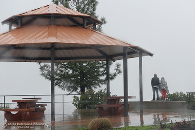 People weather the rain to check out Lake Oroville from the Vista Point above the dam Thursday Feb. 8, 2017.   (Bill Husa -- Enterprise-Record)