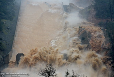 As more water makes it's way down the damaged spillway, mud and debris spray and tumble as they find a new path to the Feather River at the Oroville Dam Spillway Wednesday Feb. 8, 2017. (Bill Husa -- Enterprise-Record)