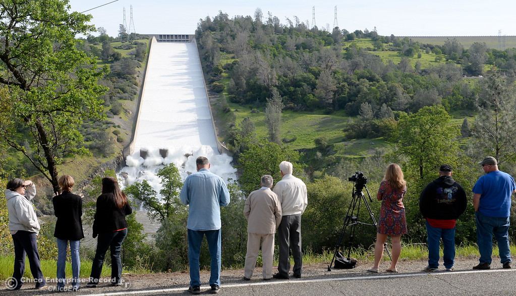 . People watch as the Lake Oroville Dam controlled spillway flows with substantial water for the first time in a long time Thurs. March 24, 2016. (Bill Husa -- Enterprise-Record)