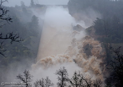 Mud, rocks and concrete mingle with the water as the Lake Oroville Dam controlled Spillway crumbles Thursday Feb. 8, 2017.  Erosion along the left side continues to increase as the spillway falls apart. (Bill Husa -- Enterprise-Record)