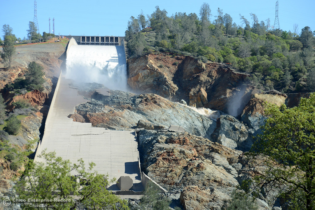 . Water pours down the Oroville Dam spillway as flows are increased Friday, March 17, 2017, to 50,000 cubic feet per second in Oroville, California. (Dan Reidel -- Enterprise-Record)