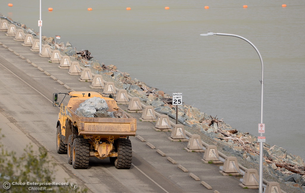 . Large trucks continue to carry material across the dam as repairs to the Spillway area contine on the Lake Oroville Dam Spillway in Oroville, Calif. Thurs. Feb. 16, 2017. (Bill Husa -- Enterprise-Record)