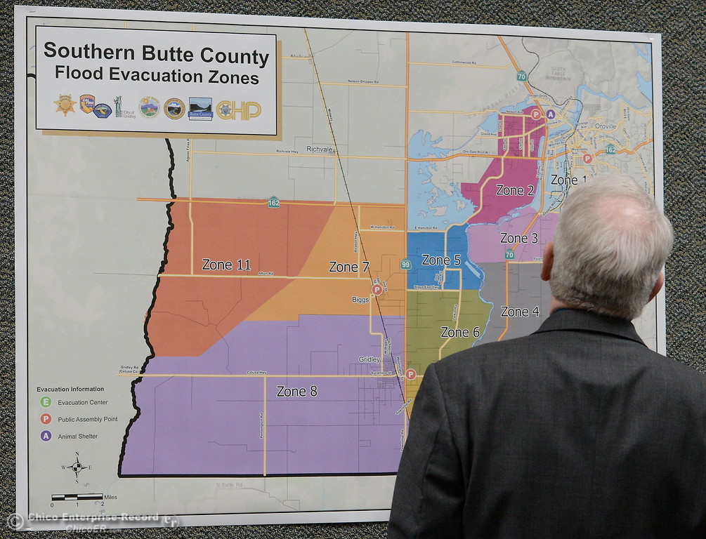 . Butte County District Attorney Mike Ramsey looks at a map during a press conference at the Butte County Sheriff\'s Dept. in Oroville to discuss Butte County evacuation plans Thurs. March 9, 2017. (Bill Husa / Chico Enterprise-Record)