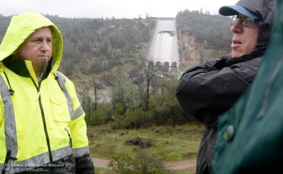 Department of Water Resources Public Information Officers Chris Orrock left and Eric See talk about a 20,000 cfs test the DWR performed on the damaged Oroville Dam Spillway Wednesday Feb. 8, 2017. (Bill Husa -- Enterprise-Record)