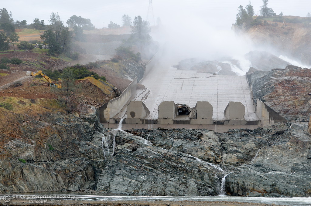. Work continues around the area as approximately 20,000 CFS flows down the rocky gorge beside the Lake Oroville Dam Spillway Tues. May 16, 2017. (Bill Husa -- Enterprise-Record)