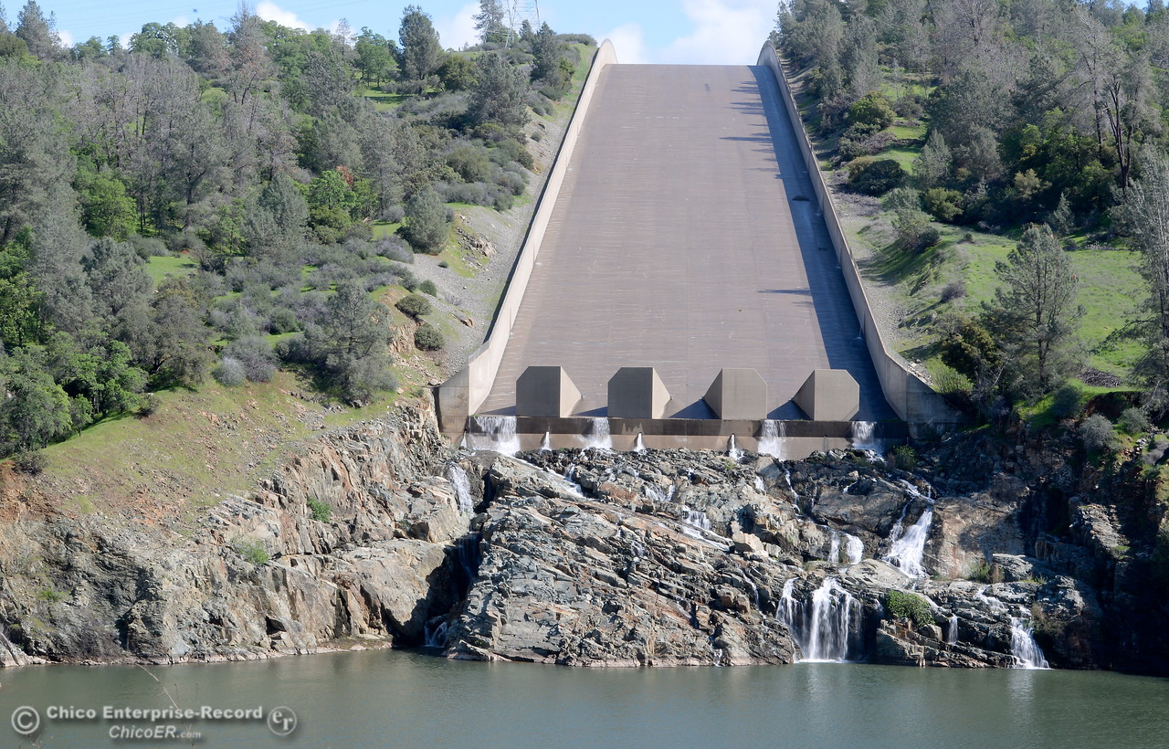 A trickle of water is seen flowing down the spillway of the Lake Oroville Dam at Lake Oroville Monday March 14, 2016. (Bill Husa -- Enterprise-Record)