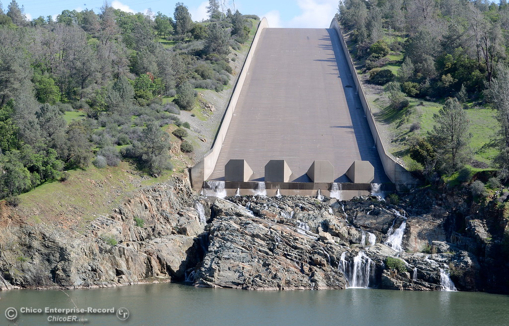 . A trickle of water is seen flowing down the spillway of the Lake Oroville Dam at Lake Oroville Monday March 14, 2016. (Bill Husa -- Enterprise-Record)