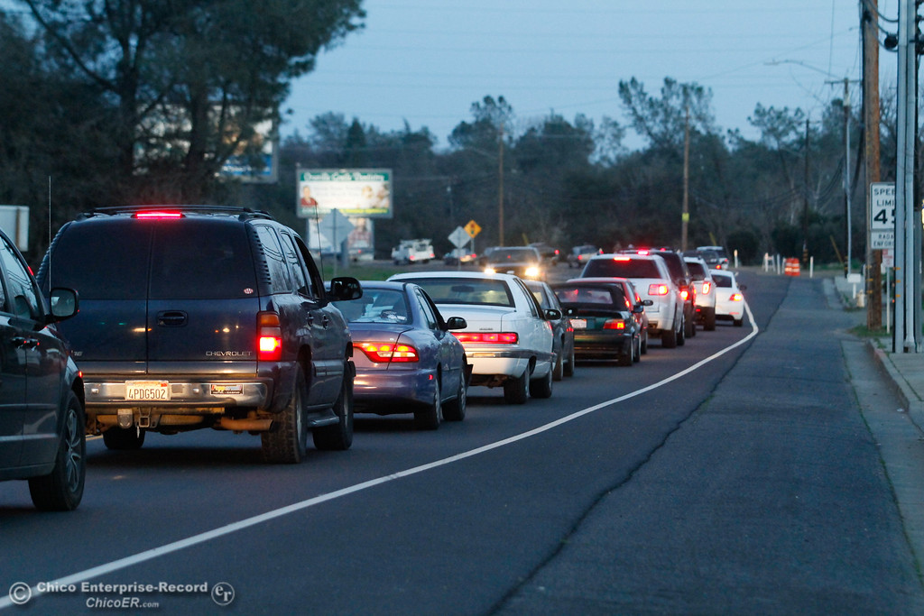 . Traffic piles up along Highway 162 near Lower Wyandotte Road as Oroville residents head to the hills after an emergency evacuation warming spread through town February 12, 2017 in Oroville, California. (Emily Bertolino -- Enterprise-Record)