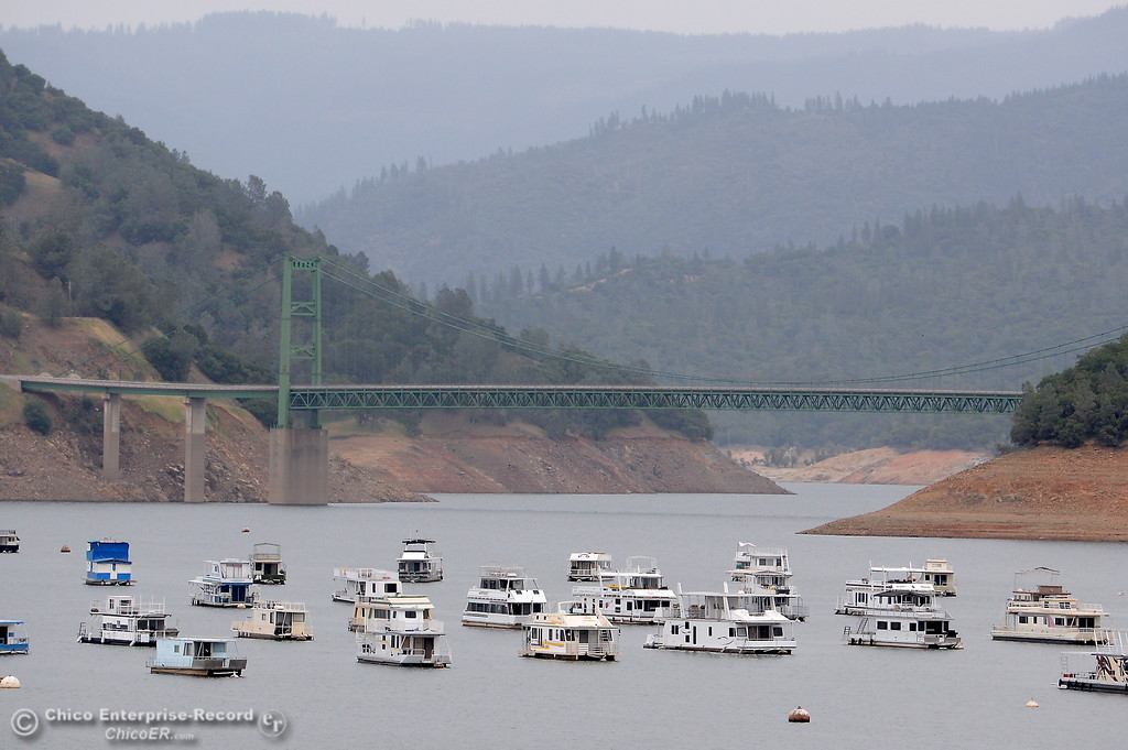 . Houseboats float on at the Lake Oroville Tues. May 16, 2017. (Bill Husa -- Enterprise-Record)