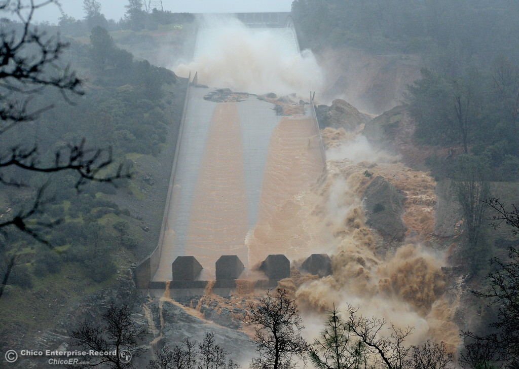 . Water begins to hit the damaged section of the Oroville Dam controlled Spillway in this photo. Much of the water is now travelling down the left side of the spillway. The hole continues to grow larger as water is released Thursday Feb. 8, 2017.  Erosion along the left side continues to increase as the spillway falls apart. (Bill Husa -- Enterprise-Record)