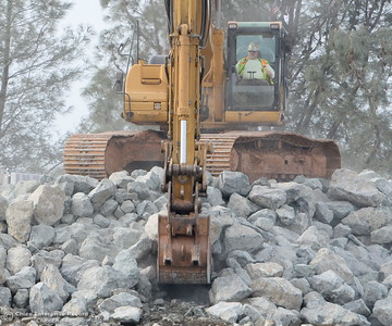 Heavy equipment is seen loading rocks as the Lake Oroville Dam Spillway emergency continues in Oroville, Calif. Mon. Feb. 13, 2017. (Bill Husa -- Enterprise-Record)