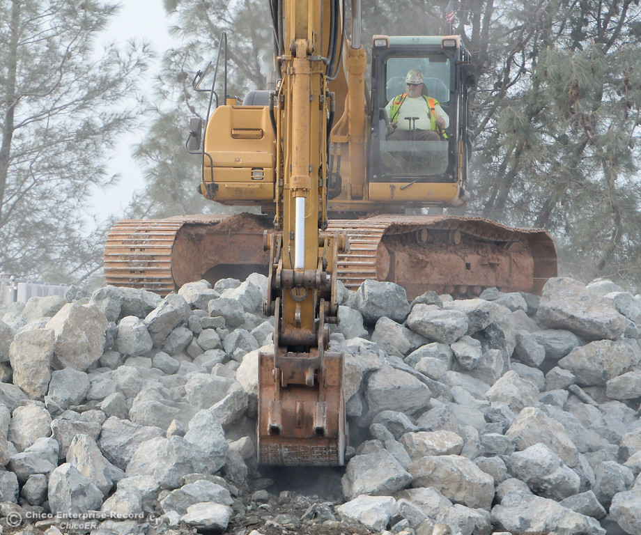 . Heavy equipment is seen loading rocks as the Lake Oroville Dam Spillway emergency continues in Oroville, Calif. Mon. Feb. 13, 2017. (Bill Husa -- Enterprise-Record)