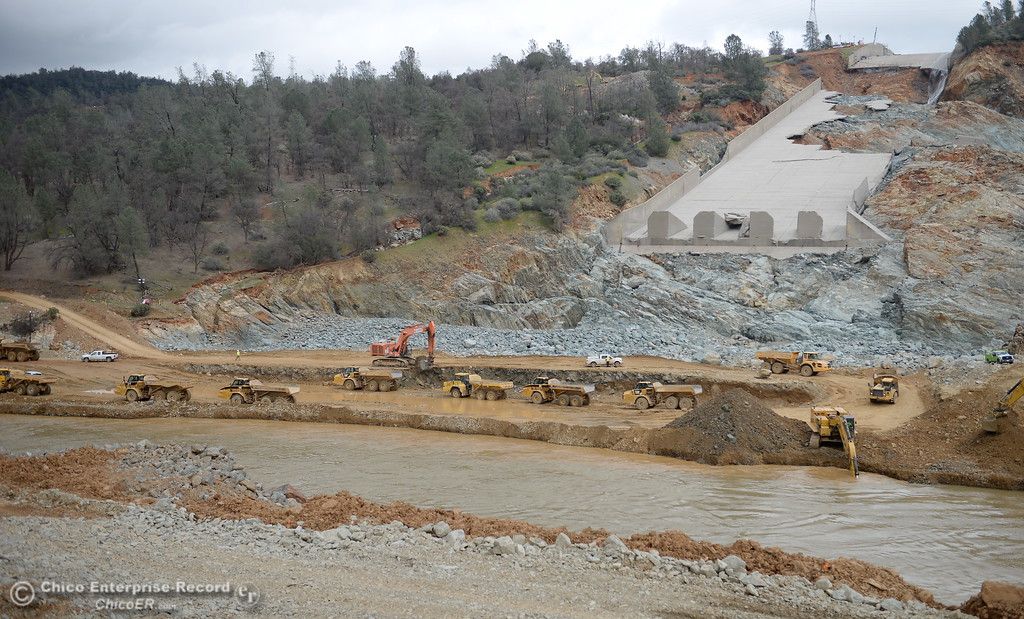 . Many dumptrucks are seen as work continues to remove debris from below the Oroville Dam spillway Monday March 6, 2017.  (Bill Husa -- Enterprise-Record)