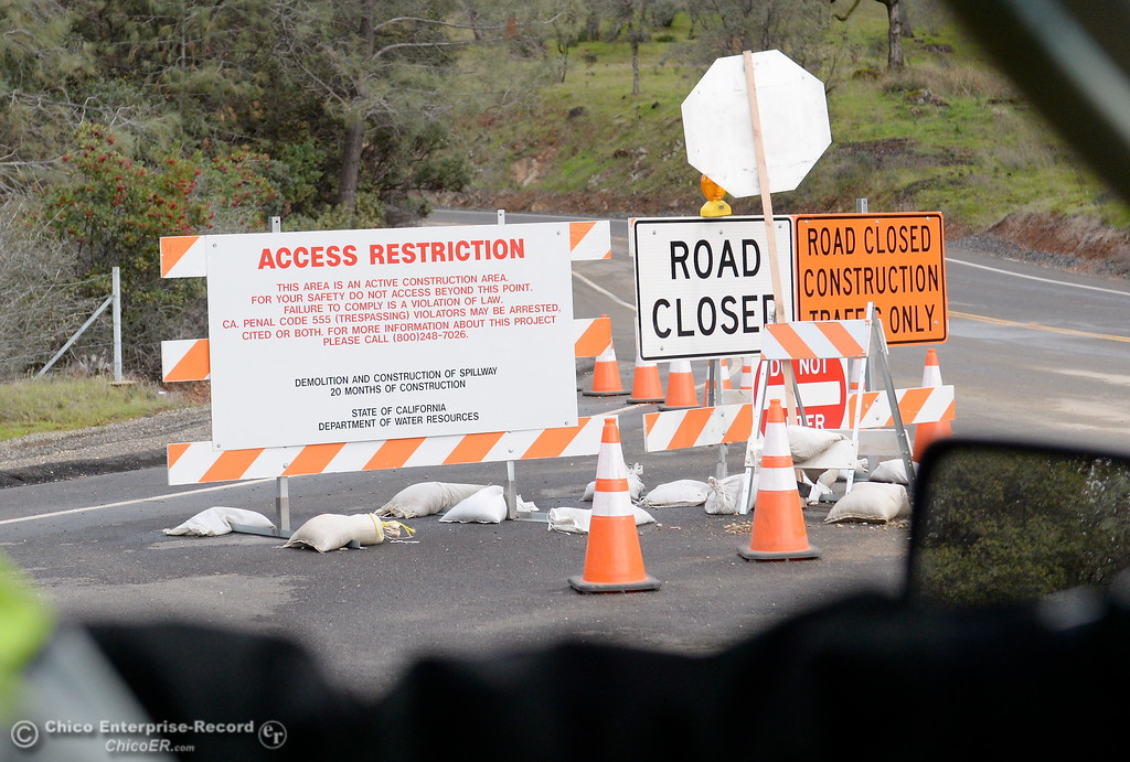 . Access restriction signs are seen near the intersection of Oro Dam Blvd. East and Canyon Drive during a look at the ongoing construction around the spillway and Lake Oroville Dam area Friday Jan. 26, 2018.  Bill Husa -- Enterprise-Record)