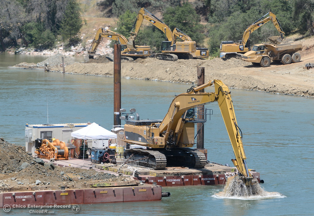 . Excavators work close together downstream from the spillway in the Diversion Pool as construction continues on the Lake Oroville Dam Spillway Wednesday May 24, 2017.  (Bill Husa -- Enterprise-Record)