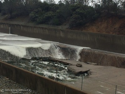 The Lake Oroville Dam controlled spillway has sustained erosion damage seen here Tues. Feb. 7, 2017. (Bill Husa -- Enterprise-Record)