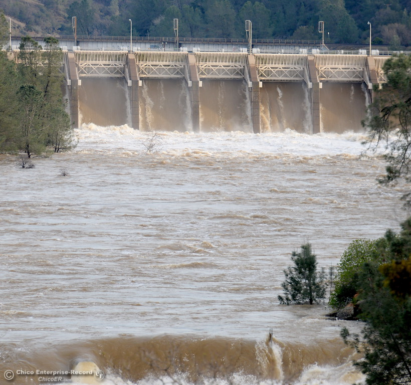 . Water flows through the Diversion Dam and over the Fish Barrier Dam as the Lake Oroville Dam Spillway emergency continues in Oroville, Calif. Mon. Feb. 13, 2017. (Bill Husa -- Enterprise-Record)