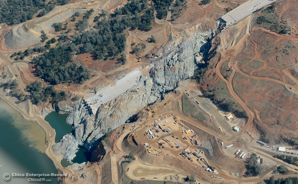 . Damage to the controlled spillway and work underway in the surrounding area is seen during a flight over the Lake Oroville Dam Spillway with Oroville Pilot Gonzalo Pee Wee Curiel Friday May 26, 2017. (Bill Husa -- Enterprise-Record)