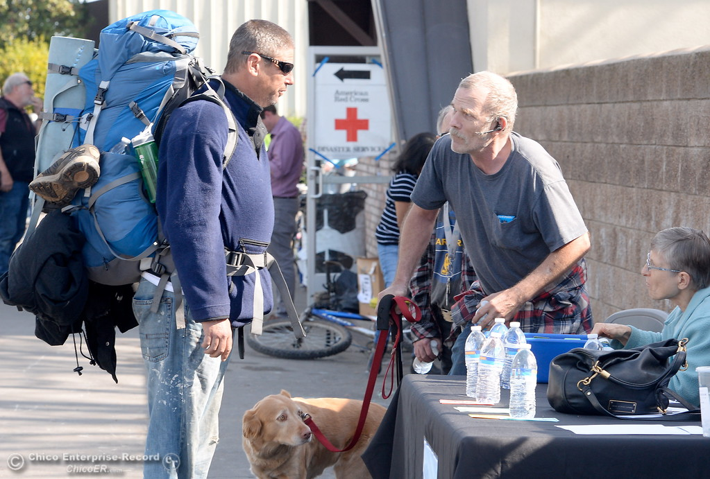 . At left, David Town talks with people at the Silver Dollar Fairgrounds as the Lake Oroville Dam Spillway emergency continues in Oroville, Calif. Tues. Feb. 14, 2017. (Bill Husa -- Enterprise-Record)