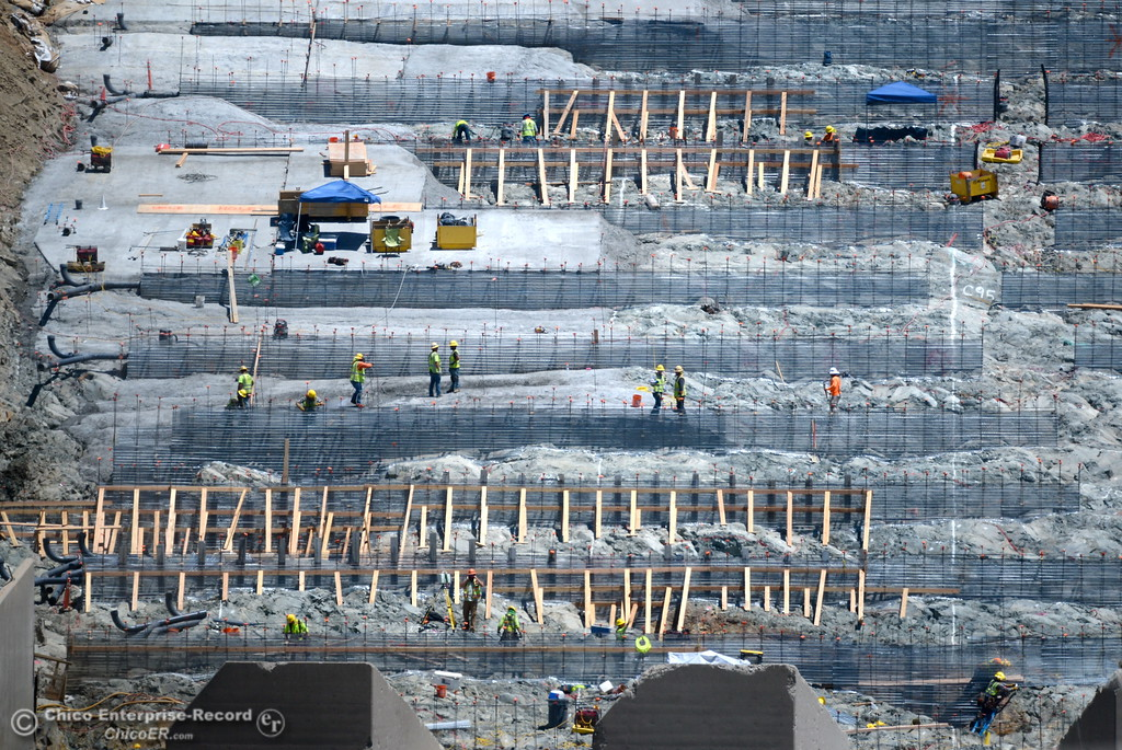 . Cranes and workers can be seen around the Spillway as construction continues at the Lake Oroville Dam Spillway Monday 7-17-2017. (Bill Husa -- Enterprise-Record)