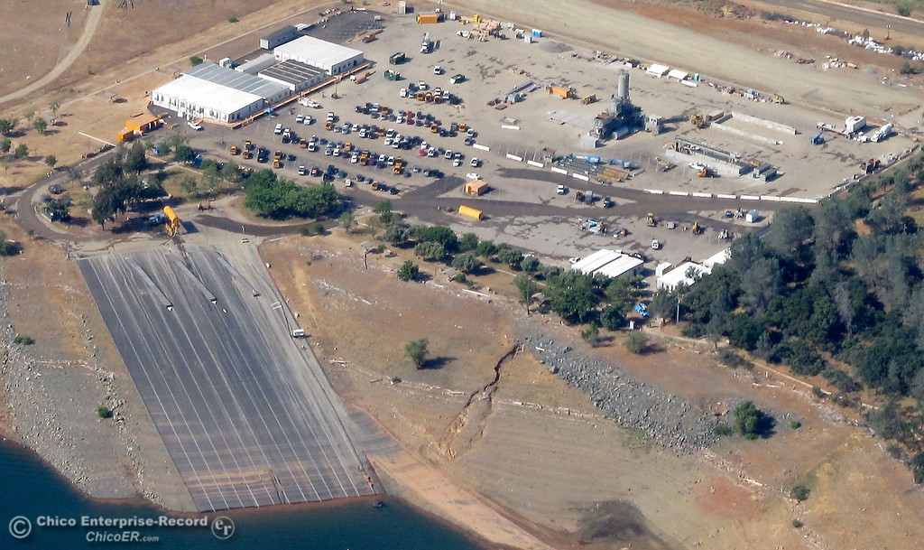 . Cars and buildings are seen in the Spillway Launch Facility parking lot during a flight over the Lake Oroville Dam Spillway with Oroville Pilot Gonzalo Pee Wee Curiel Friday May 26, 2017. (Bill Husa -- Enterprise-Record)