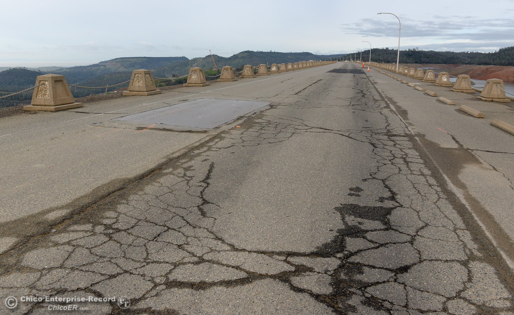 . The road on top of the Lake Oroville Dam has seen a lot of heavy truck traffic this past year and shows substantial wear and deterioration seen during a look at the ongoing construction around the spillway and Lake Oroville Dam area Friday Jan. 26, 2018.  Bill Husa -- Enterprise-Record)