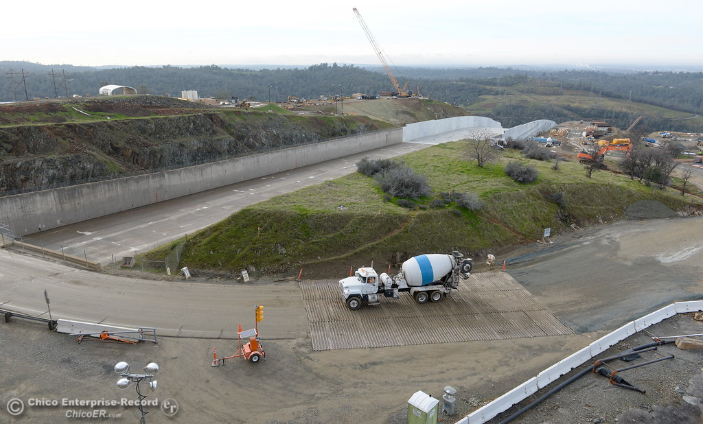 . A cement truck drives across a ribbed metal section likely designed to shake loose debris from vehicles before they get to the paved section of roadway during a look at the ongoing construction around the spillway and Lake Oroville Dam area Friday Jan. 26, 2018.  Bill Husa -- Enterprise-Record)