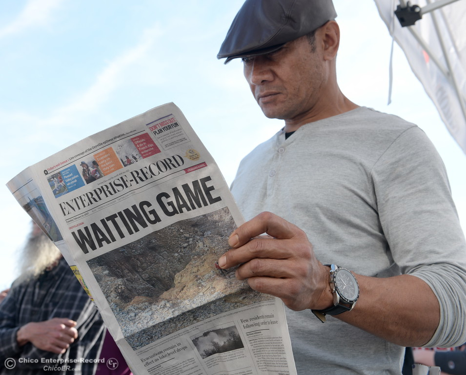 . Moe Taamai of Oroville reads the local paper as he waits for more information at the Silver Dollar Fairgounds as the Lake Oroville Dam Spillway emergency continues in Oroville, Calif. Tues. Feb. 14, 2017. (Bill Husa -- Enterprise-Record)