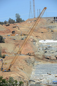 An enormous crane moves a box of onto the spillway as construction continues Saturday, July 1, 2017, at the Oroville Dam spillway in Oroville, California. (Dan Reidel -- Enterprise-Record)