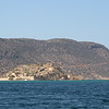 Spinalonga island.  The island is very small (0.033 square miles).  On it are the ruins of a Venetian fortress.  In the first half of the 20th century, the island was a leper colony.
