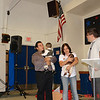 Farfan Family presenting their boys to the Lord.