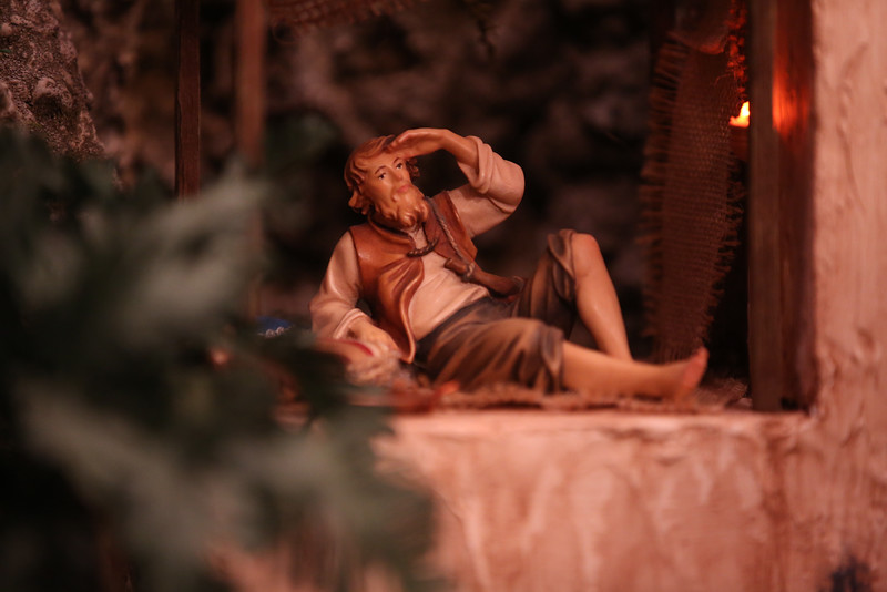 A townsman observes activity on a street in Bethlehem. The overall display tries to capture everyday life in the city where Jesus was born.