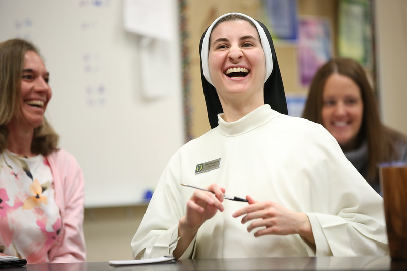 8:19 a.m. St. Croix Catholic School, Stillwater: Sr. Magdalena Dudenhoeffer reacts to a remark Principal Sr. Mary Juliana Cox made during a meeting before school.